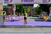 2 June 2019; Aoibhe Richardson from Kilkenny City Harriers crosses the finish line, winning the 2019 Vhi Women's Mini Marathon. 30,000 women from all over the country took to the streets of Dublin to run, walk and jog the 10km route, raising much needed funds for hundreds of charities around the country. www.vhiwomensminimarathon.ie. Photo by Sam Barnes/Sportsfile