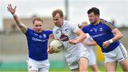 2 June 2019; Peter Kelly of Kildare in action against Gary Rogers, right, and Barry McKeon of Longford during Leinster GAA Football Senior Championship Quarter-Final Replay match between Longford and Kildare at Bord na Mona O'Connor Park in Tulamore, Offaly. Photo by Matt Browne/Sportsfile