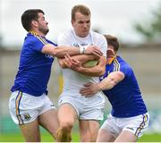 2 June 2019; Peter Kelly of Kildare in action against Barry McKeon, left, and Gary Rogers of Longford during Leinster GAA Football Senior Championship Quarter-Final Replay match between Longford and Kildare at Bord na Mona O'Connor Park in Tulamore, Offaly. Photo by Matt Browne/Sportsfile