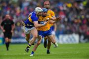 2 June 2019; Shane O'Donnell of Clare, supported by team-mate John Conlon, behind, in action against Pádraic Maher of Tipperary during the Munster GAA Hurling Senior Championship Round 3 match between Clare and Tipperary at Cusack Park in Ennis, Co Clare. Photo by Piaras Ó Mídheach/Sportsfile
