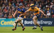 2 June 2019; Jason Forde of Tipperary in action against Seadna Morey of Clare during the Munster GAA Hurling Senior Championship Round 3 match between Clare and Tipperary at Cusack Park in Ennis, Co. Clare. Photo by Diarmuid Greene/Sportsfile