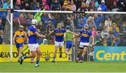 2 June 2019; Noel McGrath of Tipperary, centre, celebrates scoring his side's first goal with team-mate John McGrath, right, during the Munster GAA Hurling Senior Championship Round 3 match between Clare and Tipperary at Cusack Park in Ennis, Co Clare. Photo by Piaras Ó Mídheach/Sportsfile