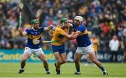 2 June 2019; Jack Browne of Clare in action against John O'Dwyer, left, and Patrick Maher of Tipperary during the Munster GAA Hurling Senior Championship Round 3 match between Clare and Tipperary at Cusack Park in Ennis, Co. Clare. Photo by Diarmuid Greene/Sportsfile