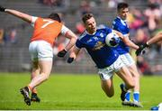 2 June 2019; Conor Madden of Cavan in action against Aidan Forker of Armagh during the Ulster GAA Football Senior Championship Semi-Final match between Cavan and Armagh at St Tiernach's Park in Clones, Monaghan. Photo by Oliver McVeigh/Sportsfile