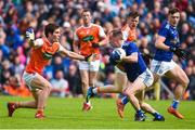 2 June 2019; Martin Reilly of Cavan in action against Jarleth Óg Burns of Armagh during the Ulster GAA Football Senior Championship Semi-Final match between Cavan and Armagh at St Tiernach's Park in Clones, Monaghan. Photo by Oliver McVeigh/Sportsfile