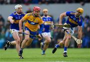 2 June 2019; John Conlon of Clare in action against Pádraic Maher, left, and Barry Heffernan of Tipperary during the Munster GAA Hurling Senior Championship Round 3 match between Clare and Tipperary at Cusack Park in Ennis, Co Clare. Photo by Piaras Ó Mídheach/Sportsfile