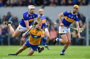 2 June 2019; John Conlon of Clare is fouled by Pádraic Maher of Tipperary, left, as team-mate Barry Heffernan looks on during the Munster GAA Hurling Senior Championship Round 3 match between Clare and Tipperary at Cusack Park in Ennis, Co Clare. Photo by Piaras Ó Mídheach/Sportsfile
