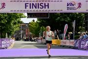 2 June 2019; Mary Mulhare of Portlaoise A.C., Co. Laois, crosses the line to finish sixth in the 2019 Vhi Women's Mini Marathon. 30,000 women from all over the country took to the streets of Dublin to run, walk and jog the 10km route, raising much needed funds for hundreds of charities around the country. www.vhiwomensminimarathon.ie.  Photo by Sam Barnes/Sportsfile