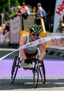 2 June 2019;  Shauna Bocquet from Galway, crosses the finish line to win the Wheelchair Category during 2019 Vhi Women's Mini Marathon. 30,000 women from all over the country took to the streets of Dublin to run, walk and jog the 10km route, raising much needed funds for hundreds of charities around the country. www.vhiwomensminimarathon.ie.  Photo by Sam Barnes/Sportsfile