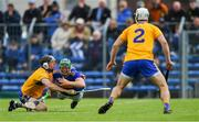 2 June 2019; John O'Dwyer of Tipperary in action against David McInerney of Clare, as Patrick O'Connor, 2, looks on during the Munster GAA Hurling Senior Championship Round 3 match between Clare and Tipperary at Cusack Park in Ennis, Co Clare. Photo by Piaras Ó Mídheach/Sportsfile