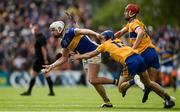 2 June 2019; Pádraic Maher of Tipperary in action against Shane O'Donnell and Peter Duggan of Clare during the Munster GAA Hurling Senior Championship Round 3 match between Clare and Tipperary at Cusack Park in Ennis, Co. Clare. Photo by Diarmuid Greene/Sportsfile