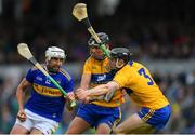 2 June 2019; Patrick Maher of Tipperary in action against Cathal Malone, centre, David McInerney of Clare during the Munster GAA Hurling Senior Championship Round 3 match between Clare and Tipperary at Cusack Park in Ennis, Co Clare. Photo by Piaras Ó Mídheach/Sportsfile