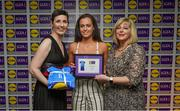 31 May 2019; The 2019 Teams of the Lidl Ladies National Football League awards were presented at Croke Park on Friday, May 31. The best players from the four divisions in the Lidl National Football Leagues were selected by the LGFA's All Star committee. Emma Duggan of Meath is pictured receiving her Division 3 award from Marie Hickey, Ladies Gaelic Football Association President, and Sian Gray, Head of Marketing, Lidl Ireland. Photo by David Fitzgerald/Sportsfile