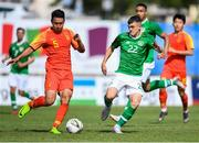 3 June 2019; Jason Knight of Ireland in action against Yang Li of China during the 2019 Maurice Revello Toulon Tournament match between China and Republic of Ireland at Stade de Lattre de Tassigny in Aubagne, France. Photo by Alexandre Dimou/Sportsfile