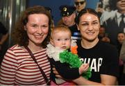 4 June 2019; Katie Taylor arrives back to Dublin Airport following her Undisputed Female World Lightweight Championship bout victory against Delfine Persoon at Madison Square Garden in New York, USA, on Saturday. Pictured is Undisputed World Lightweight Champion Katie Taylor poses for a photo with 10 month old Saoirse Spencer from Fairview, Co. Dublin and her mother Sinead Spencer at Dublin Airport in Dublin. Photo by Harry Murphy/Sportsfile