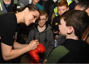 4 June 2019; Katie Taylor arrives back to Dublin Airport following her Undisputed Female World Lightweight Championship bout victory against Delfine Persoon at Madison Square Garden in New York, USA, on Saturday. Pictured is Undisputed World Lightweight Champion Katie Taylor signs a pair of gloves at Dublin Airport in Dublin. Photo by Harry Murphy/Sportsfile