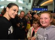 4 June 2019; Katie Taylor arrives back to Dublin Airport following her Undisputed Female World Lightweight Championship bout victory against Delfine Persoon at Madison Square Garden in New York, USA, on Saturday. Pictured Undisputed World Lightweight Champion Katie Taylor meets fans at Dublin Airport in Dublin. Photo by Harry Murphy/Sportsfile