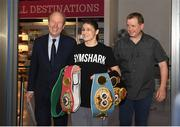 4 June 2019; Katie Taylor arrives back to Dublin Airport following her Undisputed Female World Lightweight Championship bout victory against Delfine Persoon at Madison Square Garden in New York, USA, on Saturday. Pictured is Undisputed World Lightweight Champion Katie Taylor, with Minister for Transport, Tourism and Sport Shane Ross T.D., left, and manager Brian Peters, right, at Dublin Airport in Dublin. Photo by Harry Murphy/Sportsfile