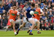 2 June 2019; Thomas Galligan of Cavan in action against Mark Shields of Armagh during the Ulster GAA Football Senior Championship Semi-Final match between Cavan and Armagh at St Tiernach's Park in Clones, Monaghan. Photo by Oliver McVeigh/Sportsfile