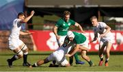 4 June 2019; Iwan Hughes of Ireland is tackled by Manu Vunipola of England during the World Rugby U20 Championship Pool B match between Ireland and England at Club De Rugby Ateneo Inmaculada in Santa Fe, Argentina. Photo by Florencia Tan Jun/Sportsfile