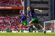 7 June 2019; James McClean, right, and Callum Robinson of Republic of Ireland warm-up prior to the UEFA EURO2020 Qualifier Group D match between Denmark and Republic of Ireland at Telia Parken in Copenhagen, Denmark. Photo by Stephen McCarthy/Sportsfile