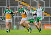 8 June 2019; Liam Gavaghan of London in action against Peter Cunningham of Offaly during the GAA Football All-Ireland Senior Championship Round 1 match between  Offaly and London at Bord na Móna O'Connor Park in Tullamore, Offaly. Photo by Harry Murphy/Sportsfile