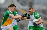 8 June 2019; Killian Butler of London in action against Johnny Moloney of Offaly during the GAA Football All-Ireland Senior Championship Round 1 match between  Offaly and London at Bord na Móna O'Connor Park in Tullamore, Offaly. Photo by Harry Murphy/Sportsfile