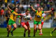 8 June 2019; Niamh O'Neill of Tyrone in action against Amy Boyle Carr, left, and Nicole McLaughlin of Donegal during the TG4 Ulster Senior Championship Preliminary Round match between Donegal and Tyrone at Kingspan Breffni Park in Cavan. Photo by Ramsey Cardy/Sportsfile