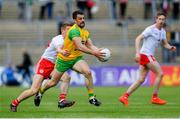 8 June 2019; Paddy McGrath of Donegal is tackled by Peter Harte of Tyrone during the Ulster GAA Football Senior Championship semi-final match between Donegal and Tyrone at Kingspan Breffni Park in Cavan. Photo by Ramsey Cardy/Sportsfile