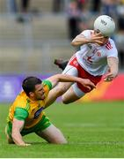 8 June 2019; Paddy McGrath of Donegal in action against Richard Donnelly of Tyrone during the Ulster GAA Football Senior Championship semi-final match between Donegal and Tyrone at Kingspan Breffni Park in Cavan. Photo by Ramsey Cardy/Sportsfile