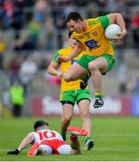 8 June 2019; Leo McLoone of Donegal in action against Matthew Donnelly of Tyrone during the Ulster GAA Football Senior Championship semi-final match between Donegal and Tyrone at Kingspan Breffni Park in Cavan. Photo by Ramsey Cardy/Sportsfile