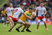 8 June 2019; Patrick McBrearty of Donegal in action against Richard Donnelly of Tyrone during the Ulster GAA Football Senior Championship semi-final match between Donegal and Tyrone at Kingspan Breffni Park in Cavan. Photo by Daire Brennan/Sportsfile