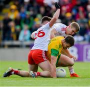 8 June 2019; Leo McLoone of Donegal in action against Liam Rafferty, left, and Pádraig Hampsey of Tyrone during the Ulster GAA Football Senior Championship semi-final match between Donegal and Tyrone at Kingspan Breffni Park in Cavan. Photo by Daire Brennan/Sportsfile