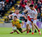 8 June 2019; Leo McLoone of Donegal in action against Tyrone players, left to right, Liam Rafferty, Ben McDonnell, and Pádraig Hampsey during the Ulster GAA Football Senior Championship semi-final match between Donegal and Tyrone at Kingspan Breffni Park in Cavan. Photo by Daire Brennan/Sportsfile