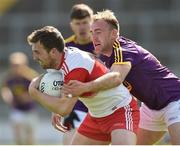 8 June 2019; Ryan Bell of Derry in action against James Cash of Wexford during the GAA Football All-Ireland Senior Championship Round 1 match between Wexford and Derry at Innovate Wexford Park in Wexford. Photo by Matt Browne/Sportsfile