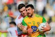 8 June 2019; Paddy McGrath of Donegal is tackled by Brian Kennedy of Tyrone during the Ulster GAA Football Senior Championship semi-final match between Donegal and Tyrone at Kingspan Breffni Park in Cavan. Photo by Ramsey Cardy/Sportsfile