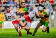 8 June 2019; Matthew Donnelly, right, supported by Tyrone team-mate Cathal McShane is tackled by Hugh McFadden, supported by Donegal team-mate Stephen McMenamin during the Ulster GAA Football Senior Championship semi-final match between Donegal and Tyrone at Kingspan Breffni Park in Cavan. Photo by Ramsey Cardy/Sportsfile