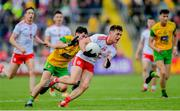 8 June 2019; Liam Rafferty of Tyrone in action against Ryan McHugh of Donegal during the Ulster GAA Football Senior Championship semi-final match between Donegal and Tyrone at Kingspan Breffni Park in Cavan. Photo by Ramsey Cardy/Sportsfile