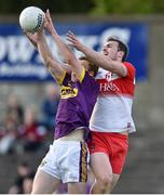 8 June 2019; Michael Furlong of Wexford in action against Ryan Bell of Derry during the GAA Football All-Ireland Senior Championship Round 1 match between Wexford and Derry at Innovate Wexford Park in Wexford. Photo by Matt Browne/Sportsfile