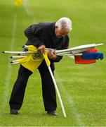 8 June 2019; Groundsman Benny Markey places flags around the ground before the GAA Football All-Ireland Senior Championship Round 1 match between Louth and Antrim at Gaelic Grounds in Drogheda, Louth. Photo by Ray McManus/Sportsfile
