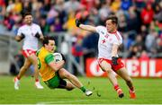 8 June 2019; Eoin McHugh of Donegal in action against Kieran McGeary of Tyrone during the Ulster GAA Football Senior Championship semi-final match between Donegal and Tyrone at Kingspan Breffni Park in Cavan. Photo by Ramsey Cardy/Sportsfile