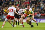 8 June 2019; Hugh McFadden of Donegal in action against Frank Burns, left, and Darren McCurry of Tyrone during the Ulster GAA Football Senior Championship semi-final match between Donegal and Tyrone at Kingspan Breffni Park in Cavan. Photo by Daire Brennan/Sportsfile