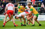 8 June 2019; Darren McCurry of Tyrone in action against Michael Langan, left, and Stephen McMenamin of Donegal during the Ulster GAA Football Senior Championship semi-final match between Donegal and Tyrone at Kingspan Breffni Park in Cavan. Photo by Ramsey Cardy/Sportsfile