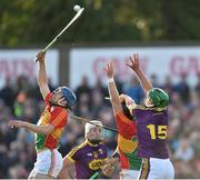 8 June 2019; Michael Doyle and Richard Coady of Carlow in action against Conor McDonald of Wexford during the Leinster GAA Hurling Senior Championship Round 4 match between Wexford and Carlow at Innovate Wexford Park in Wexford. Photo by Matt Browne/Sportsfile