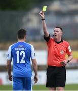 8 June 23019; Referee Damien McGrath issues a yellow card to Mark Russell of Finn Harps during the SSE Airtricity League Premier Division match between Finn Harps and Dundalk at Finn Park in Ballybofey, Donegal. Photo by Oliver McVeigh/Sportsfile
