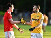 8 June 2019; Ricky Johnston of Antrim is congratulated by  Tommy Durnin of Louth after GAA Football All-Ireland Senior Championship Round 1 match between Louth and Antrim at Gaelic Grounds in Drogheda, Louth. Photo by Ray McManus/Sportsfile