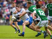 9 June 2019; Conor Boyle of Monaghan in action against Ulthem Kelm of Fermanagh during the GAA Football All-Ireland Senior Championship Round 1 match between Monaghan and Fermanagh at St Tiarnach's Park in Clones, Monaghan. Photo by Oliver McVeigh/Sportsfile