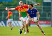 9 June 2019; Donal McElligott of Longford in action against Conor Doyle of Carlow during the GAA Football All-Ireland Senior Championship Round 1 match between Carlow and Longford at Netwatch Cullen Park in Carlow. Photo by Ramsey Cardy/Sportsfile