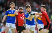 9 June 2019; Shane O'Connell of Tipperary is tackled by Conor Francis of Down during the GAA Football All-Ireland Senior Championship Round 1 match between Down and Tipperary at Pairc Esler in Newry, Down. Photo by David Fitzgerald/Sportsfile