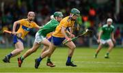9 June 2019; Conner Hegarty of Clare in action against Patrick Kirby of Limerick during the Electric Ireland Munster Minor Hurling Championship match between Limerick and Clare at the LIT Gaelic Grounds in Limerick. Photo by Diarmuid Greene/Sportsfile